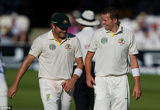 Still smiling: Siddle shares a joke with fellow Australia fast bowler Ryan Harris towards the close of play