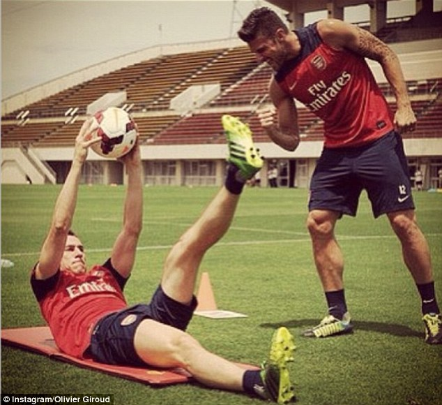 Come on! Olivier Giroud gives Laurent Koscielny some encouragment