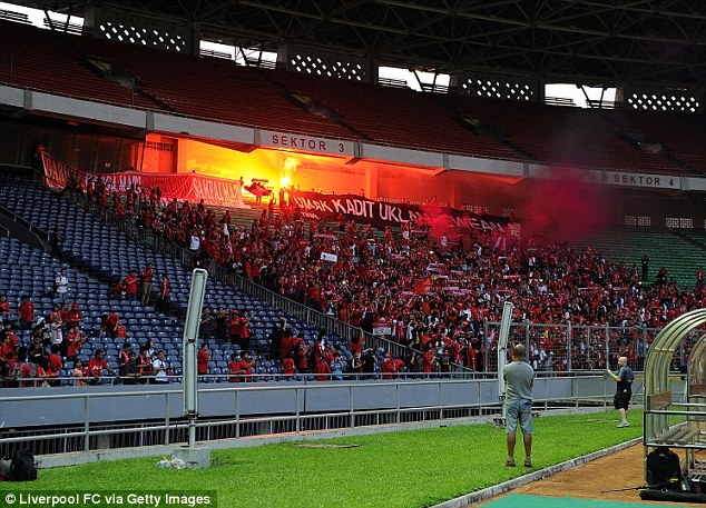 Colourful: Liverpol fans watch a training session in Jakarta