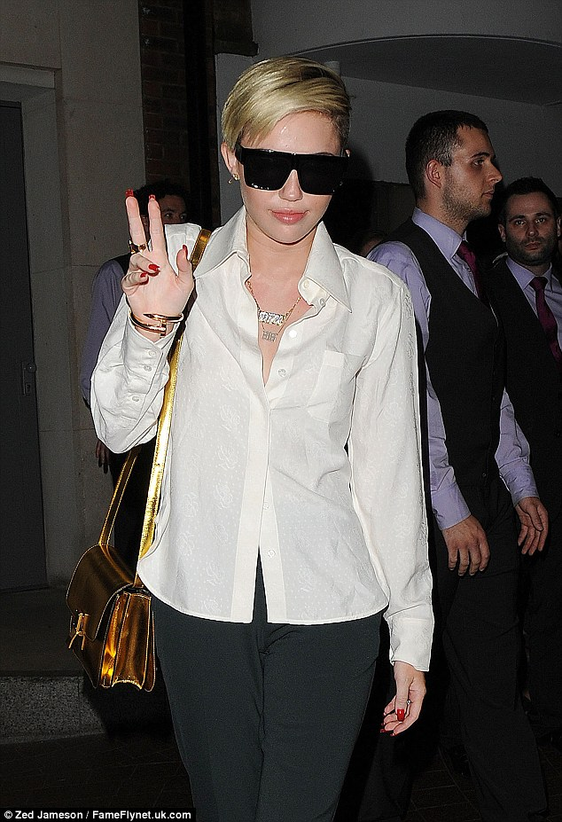 Stylish: Miley sported this sleek outfit as she went out in London on Friday evening