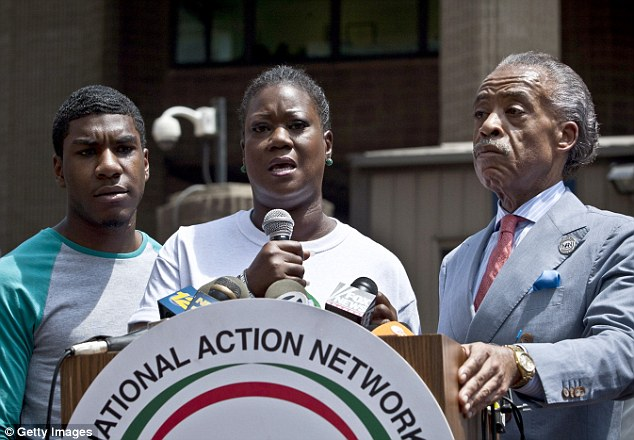 Emotional: Trayvon's mother Sybrina Fulton is joined by her son, Jahvaris, left, and the Rev Al Sharpton as she speaks in New York