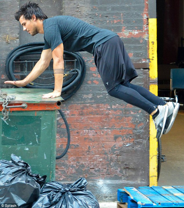 Easy peasy: The 21-year-old barely broke a sweat as he hopped over various objects, including a wheelie bin