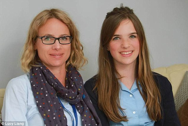 Delighted: Eliza Andre-Browning pictured with her mother who took her to see specialist surgeon Ed Gent so she could have a chance to play her violin again