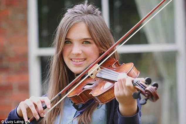 Playing again: Eliza Andre-Browning, 14, can play her violin again thanks to surgeons inserting a flexible nail in her forearm after her broken arm healed in a bent position