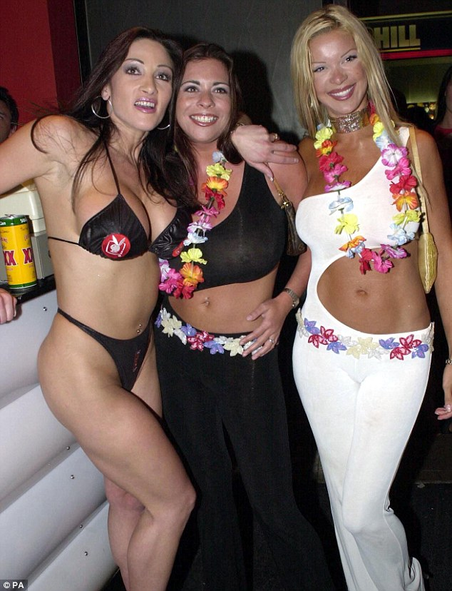 Glamour models Linsey Dawn McKenzie (centre) Kathy (l) and Alicia at a party for Front magazine, August 2001