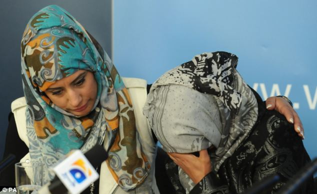 Shazia Khan (left) comforts Nazia Maqsood (right) during a press conference following the stabbing of their father Mohammed Saleem