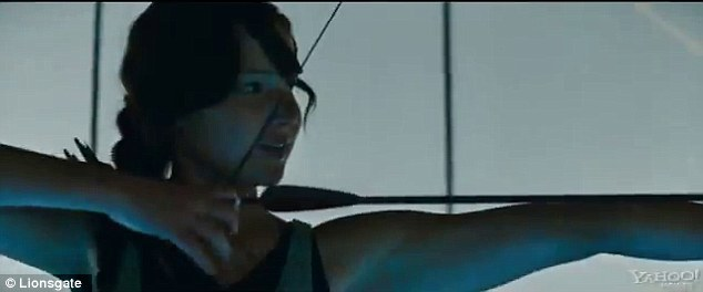Back in fighting form: Katniss draws back her bow as she trains for another round of the games
