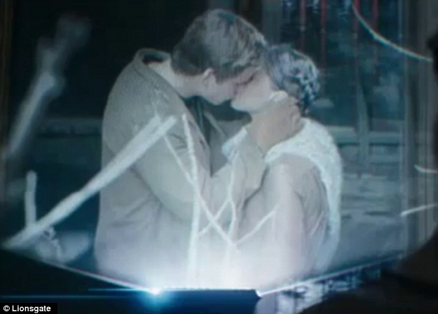 What we've been waiting for! Liam Hemsworth as Gale plants a passionate kiss on Katniss' (Jennifer Lawrence) lips in new Hunger Games: Catching Fire trailer