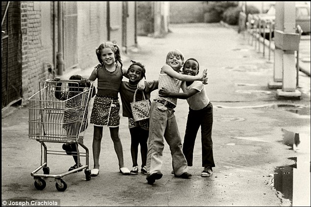 Moment of harmony: In July 1973, Joseph Crachiola was wandering the streets of Mount Clemens, Mich., when he came across (left to right) Rhonda Shelly, 3, Kathy Macool, 7, Lisa Shelly, 5, Chris Macool, 9, and Robert Shelly, 6