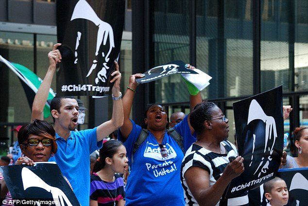 Public fury: Protesters rally in Chicago on July 20, 2013 to express anger over a not-guilty verdict in the shooting death of Trayvon Martin and call for an end to the Stand Your Ground self-defense laws