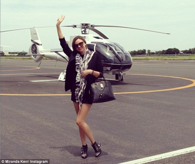 Travel duds: Miranda Kerr was a knockout in tiny black shorts and black blazer just before boarding a helicopter in Japan, an experience she shared through pictures on Twitter