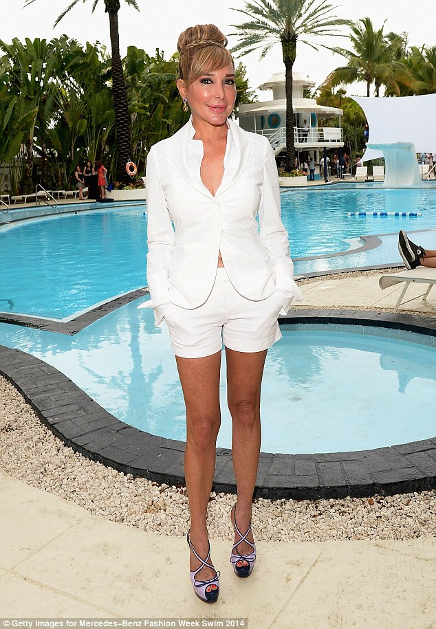 Lovely in white: Real Housewives of Miami star Marysol Patton lounged by the pool as she took a break between shows