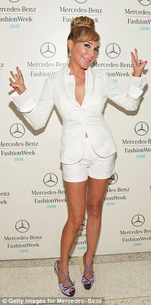 Playful: The socialite waved her hands as she posed for the cameras