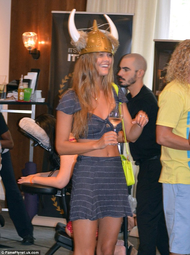 Where's the party? Nina Adgal showed off her sense of humour as she walked about in a Viking hat at the  Mercedes Benz Fashion Week in Miami, Florida on Saturday