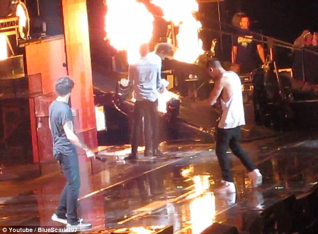 Spotted: Zayn sees Harry walking towards the pyrotechnic with a towel blocking his vision
