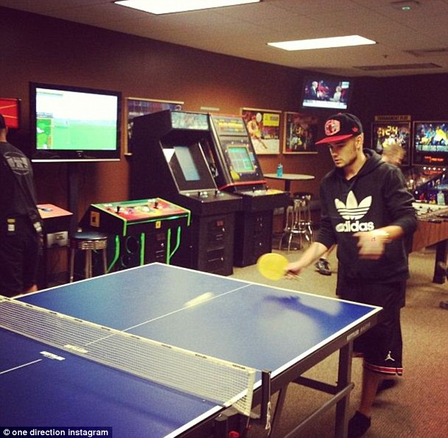 All fun and games: Liam enjoyed a game of ping pong before hitting the stage for another sell-out show