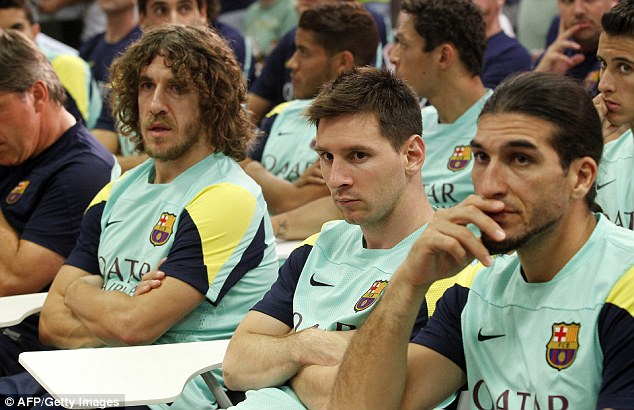 Announcement: Carles Puyol, left, Lionel Messi, middle and Jose Manuel Pinto, right, attend the press conference in which Vilanova's departure was confirmed