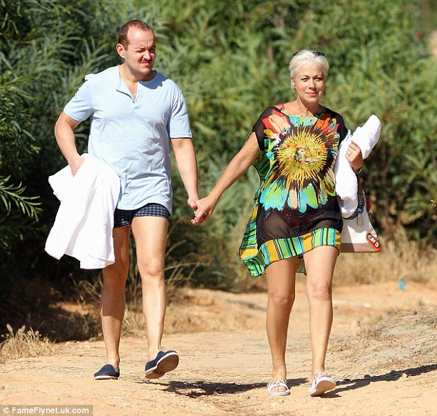 Soaking up the sun: The couple looked loved-up as they strolled hand-in-hand