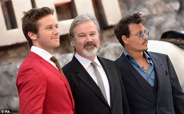 Suited and booted: The trio of men posed for photos together on Sunday evening before heading inside to the screening