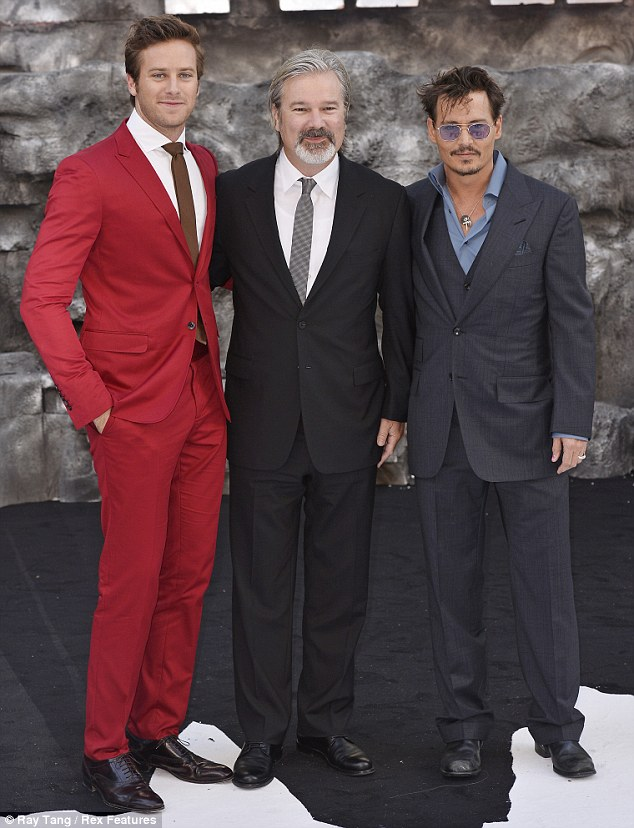 Reunited: The two lead male stars posed with director Gore Verbinski just days after the Berlin premiere