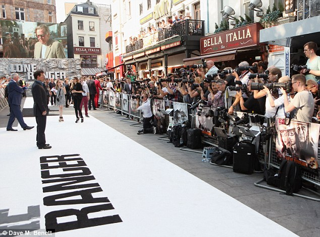 Causing a stir: Depp took his place on the carpet before greeting fans and speaking to the press