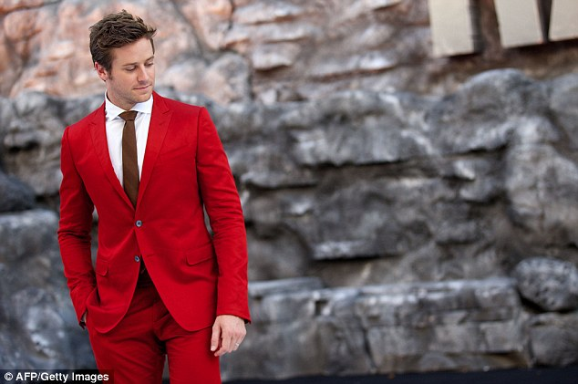 Poser: Armie certainly had all eyes on him in the red suit as he posed in front of the waiting photographers