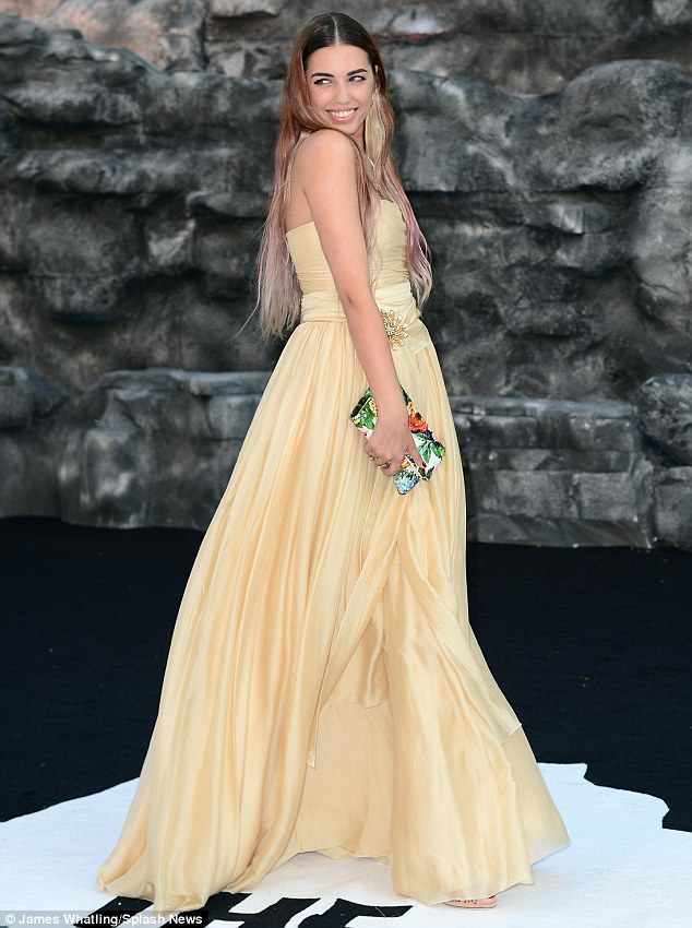 Glammed up: Amber Le Bon stole the attention in her ball gown as she posed for the cameras