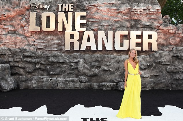 Summer brights: Former Made In Chelsea star Kimberley Garner chose a plunging yellow gown to show off at the premiere