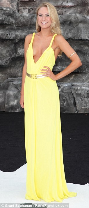 Poser: She showed off her tan and curves in the get-up as she joined the other reality stars mingling with Johnny