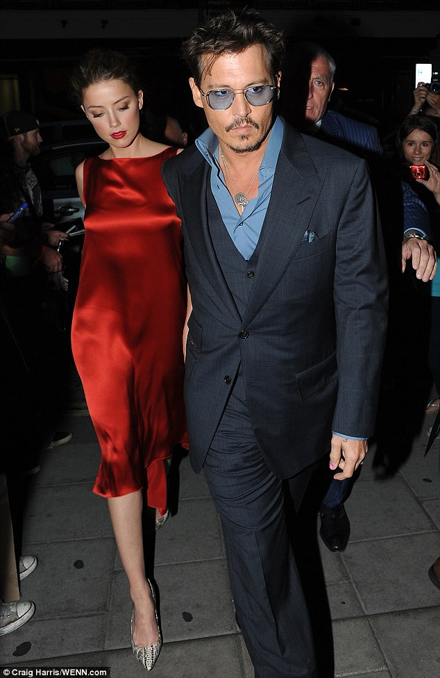 There she is! Johnny Depp takes girlfriend Amber Heard out for dinner in London after going it alone on the carpet of his The Lone Ranger premiere