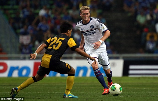 New challenge: Chelsea's Andre Schurrle playing against the a Malaysia XI