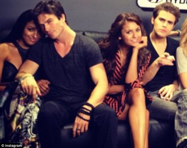 Ever professional: Former couple Nina Dobrev and Ian Somerhalder proved there is no awkwardness as the attended a Vampire Diaries event at Comic-Con over the weekend