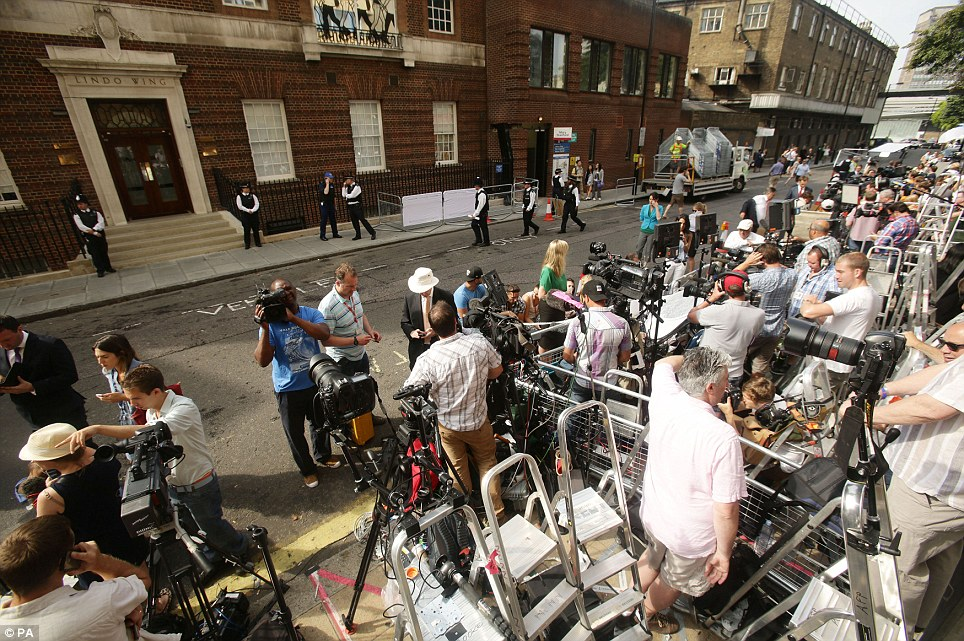 Insatiable: The press and broadcasters from all over the world are crammed into a small area outside St Mary's Hospital as they wait for the royal birth