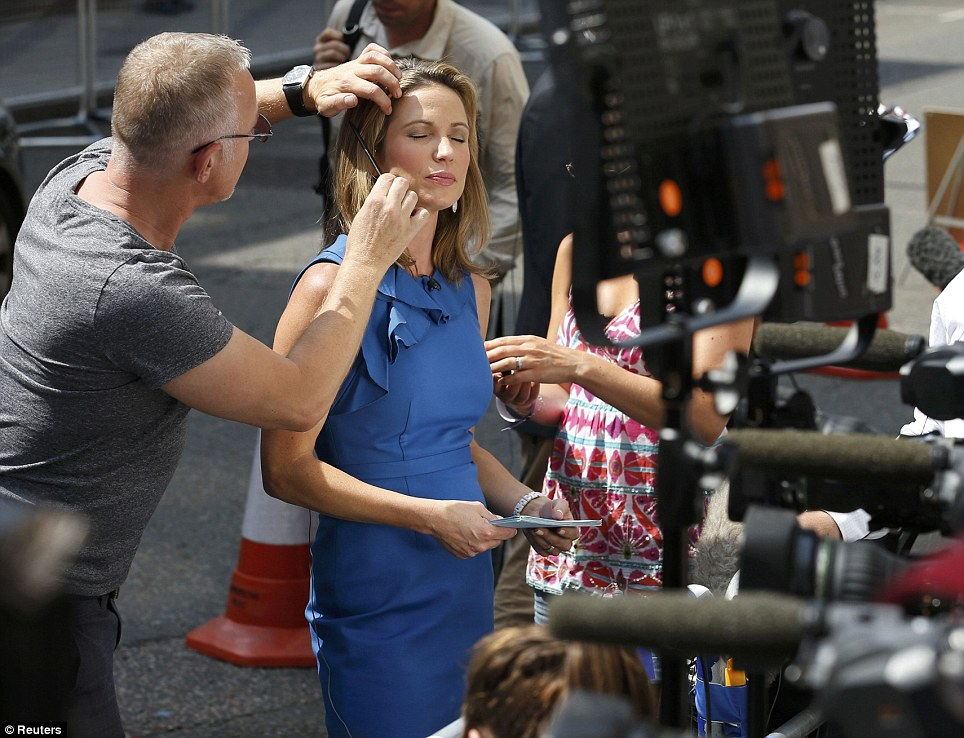 World event: Natalie Morales, of NBC in the US, has make-up applied to her face as she prepares to go live