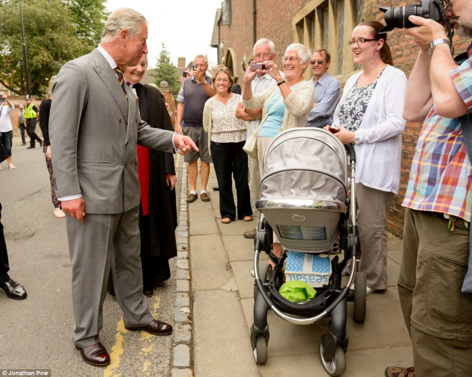 At least we know the sex of this one! Prince Charles meets a young bay outside York Minster, telling his mother India 'We are very excited'