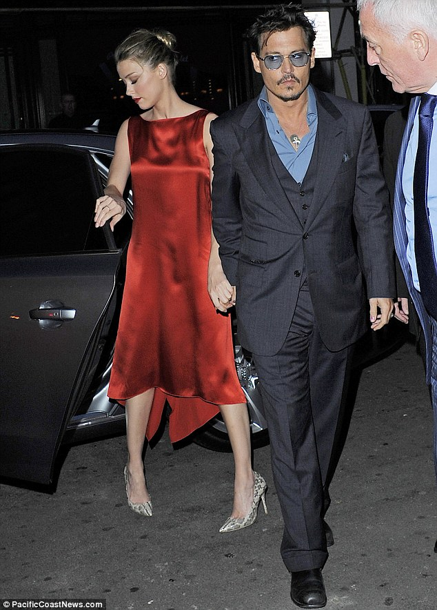 Hand-in-hand: Johnny kept a tight grip on his girlfriend as they headed inside