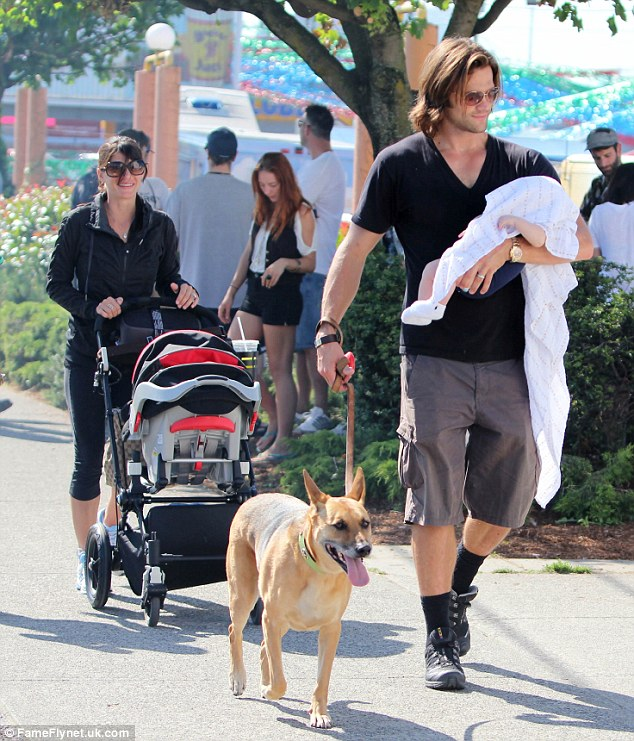 Family vacation: Jared and Genevieve took their son Thomas, in July last year, to the Vancouver Food Truck festival in Vancouver, Canada
