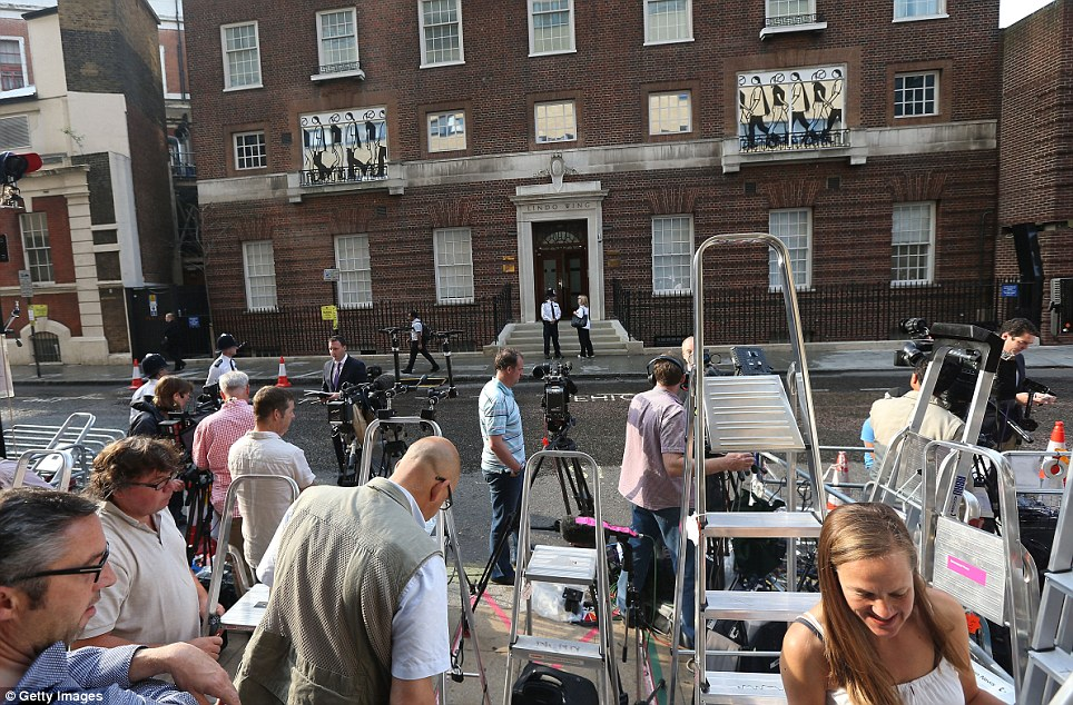 World is ready: The media gather outside the Lindo Wing this morning as the wait ends for royal fans who have been camped outside the hospital for weeks