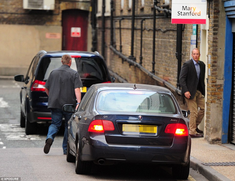 Royal arrival: The Duchess of Cambridge arrives at St Mary's Hospital, Paddington, in a people carrier with blacked out windows