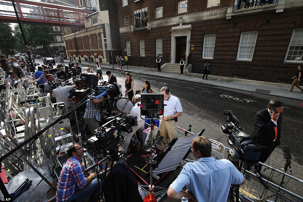 Live broadcasts: Reporters from television channels around the world broadcast from outside the hospital