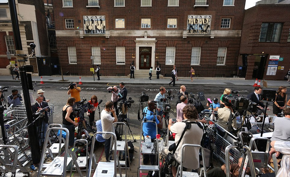 Press pack: The world's media gather outside St Mary's Hospital after it emerged that the Duchess has gone into labour