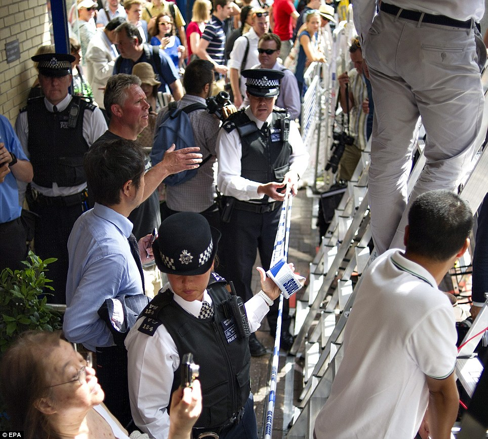 Crowded: Police, media and the public outside the Lindo Wing at St Mary's Hospital, Paddington, which Kate was admitted to