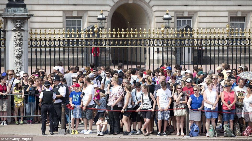 Excitement: Many tourists have travelled thousands of miles to witness the historic moment