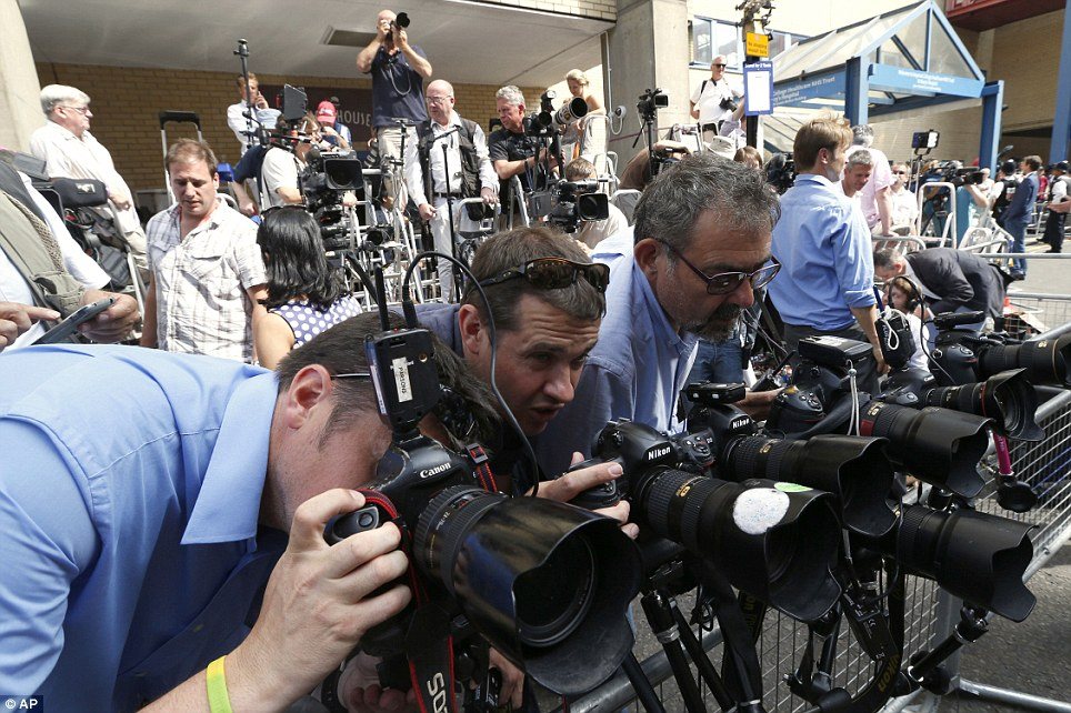 Ready and waiting: Photographers adjust their lenses outside the private Lindo Wing at St Mary's Hospital where Kate Middleton has gone into labour