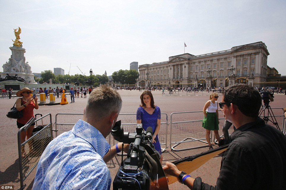 Press gathering: Broadcasters from around the world have been screening live bulletins from outside Buckingham Palace after Kate was taken to hospital