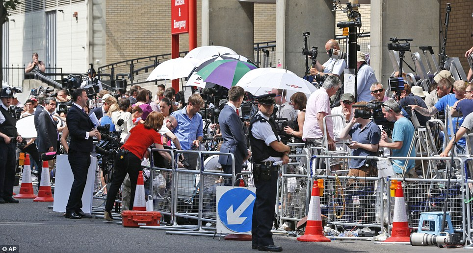 Press pack builds: Members of the media stand outside St Mary's Hospital waiting for news of the royal birth