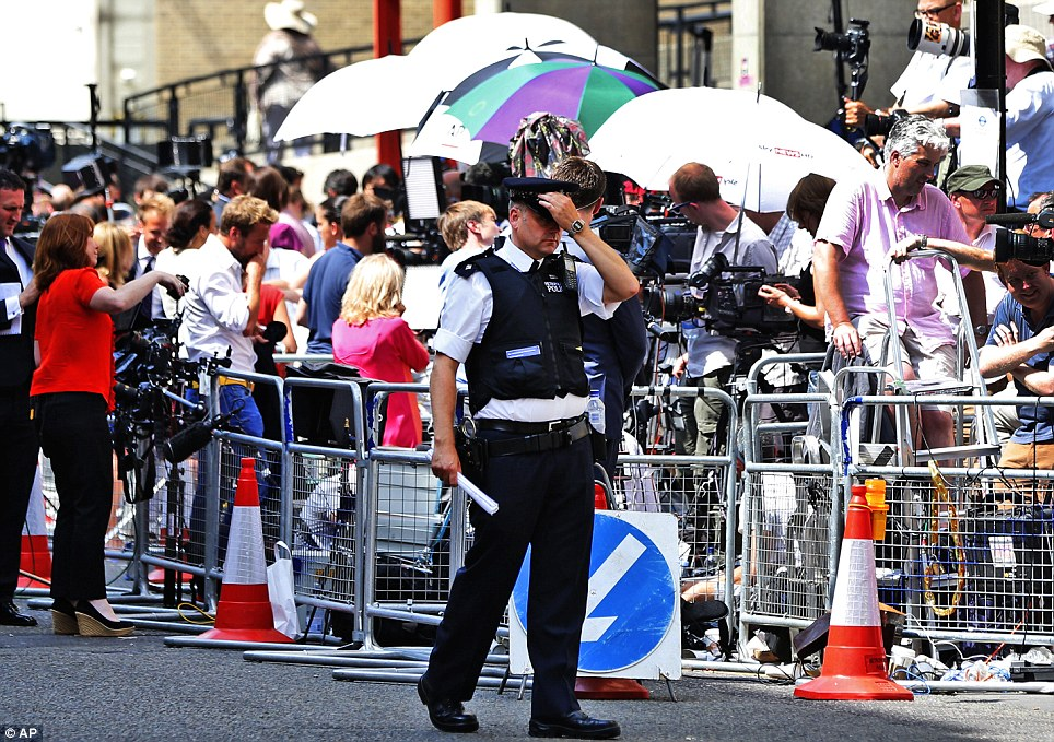 Royal birth yet? A police officer walks past the ranks of media gathered outside the Lindo Wing waiting for news about the royal birth