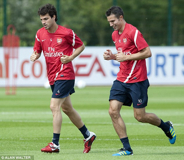 Reunion? Fabregas would join up with former Arsenal team-mate Robin van Persie (right)