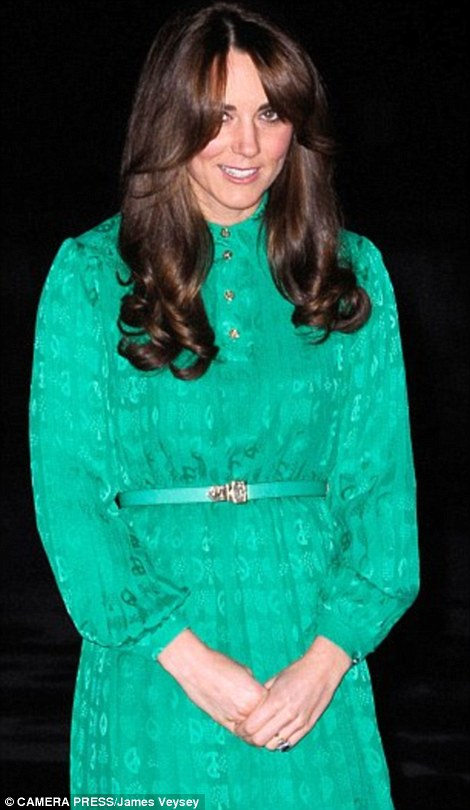 Attentive: The Duchess of Cambridge, pictured at a reception in London in November, was rushed to the King Edward VII Hospital with acute morning sickness