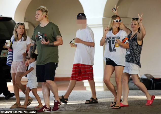 Appleton, second right, and her family appeared in high spirits during their holiday in Orlando today